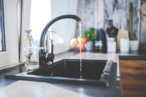 Kitchen sink and a faucet